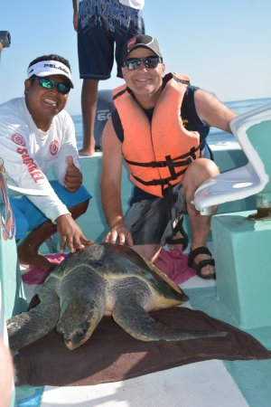 Huatulco Fishing Eduardo: Eduardo with a turtle we picked up for pictures and then released