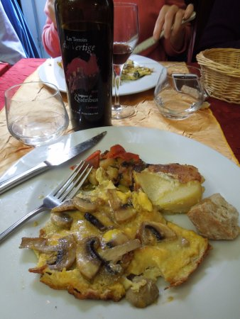 Cucugnan, France: another view of entree with bottle of wine