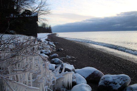 The Outpost Motel: Across the road at the Lake Superior beach in winter