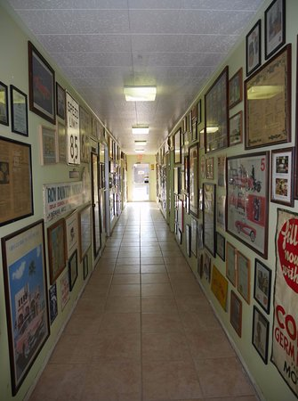 Kingman, AZ: many pictures and posters related to Route 66 are put on on the wall of corridor