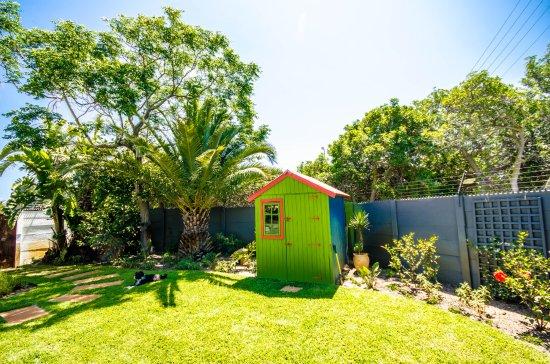 Backyard garden with the bright colour shed aviva for Garden shed tripadvisor