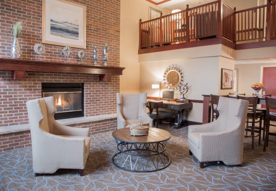 Mounds View, MN: Sit by the fireplace in our newly remodeled lobby!