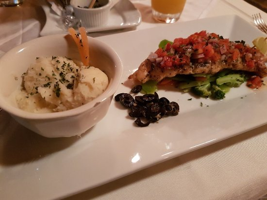 Crown Point, Tobago: Lime&Tequila Gilled Fish with Creamy Mashed Potatoes. Garlic butter olives...yum.