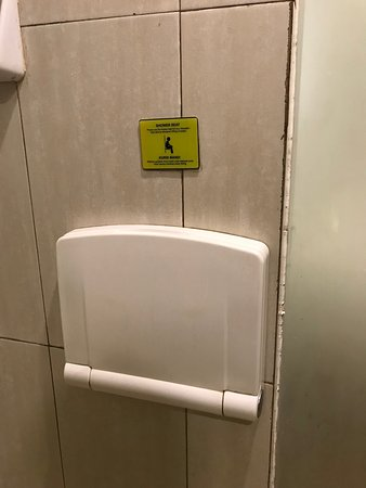 the shower provides foldable chair (?) for accessibility - Picture ...