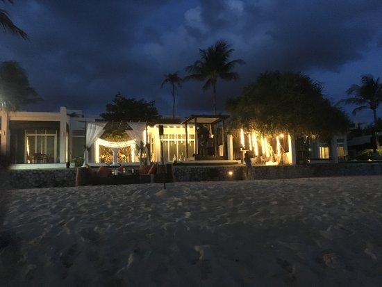Aleenta Phuket Resort & Spa: View at night from the ocean