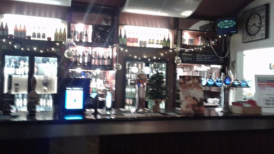 Camberley, UK: Partial view of the bar area