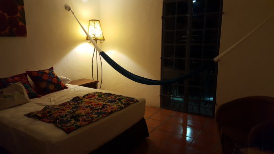 Tamarindo Bed and Breakfast: spacious room with both bed and hammock. Small  patio off - Spacious Room With Both Bed And Hammock. Small Patio Off Main Room