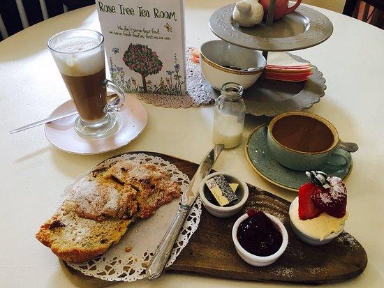 Burscough, UK: Warm scone, clotted cream, jam