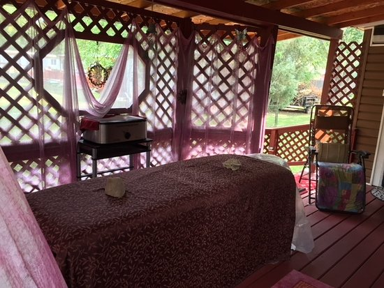 Hulett, WY: Listen to the birds sing where you may choose our peacefully secluded outdoor massage area