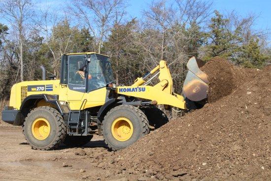 Pottsboro, TX: Front end loader - scoop it up.