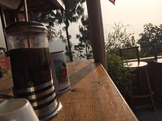 Shivapuri Heights Cottage: Nepalese coffee on the main patio