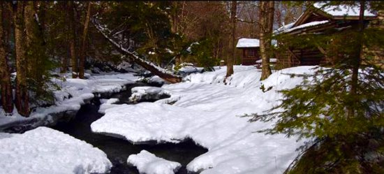 Lisbon, NH: Salmon Hole Brook in winter behind Cabin 5