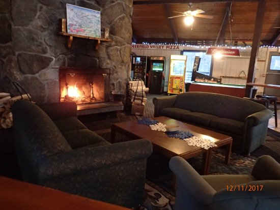 Dover, VT: lounge area with fireplace