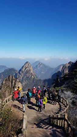 Mt. Huangshan (Yellow Mountain): A winter scene of the blue sky and mountains at a viewing platform up on Huangshan Mountain.