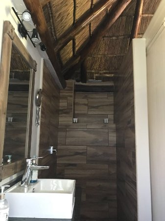 Аддо, Южная Африка: Dusche/Bad. Dach aus Reet.