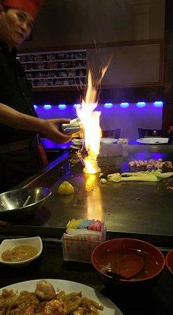 "Edohana Japanese Restaurant: Lighting onions to make the ""choo-choo"" - my 5 y/o was impressed..."