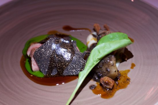 Le Normandie: Roasted lamb saddle (milk fed), black winter truffles, Jerusalem artichoke, and rocket