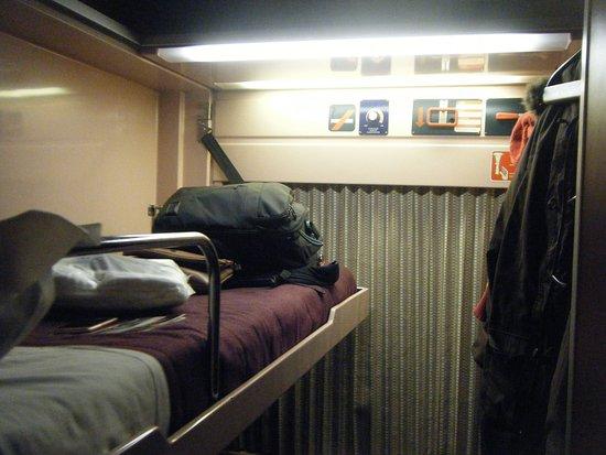 Renfe: top bed of the deluxe cabin laden with my belongings