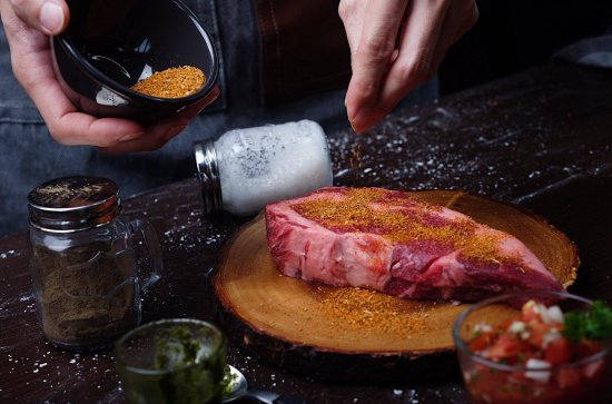 Caveman Base: rub steak with secret recipe dry rub