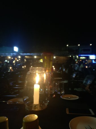 Britto's: Candle Light lamps set up the beach
