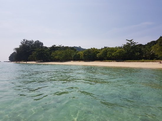 The Sevenseas Resort: My terapi on a calm island.  Wind catchers! Reef with nice diving just outside!