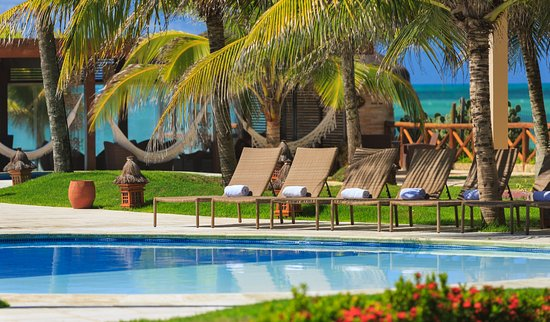 Porto de Galinhas Praia Hotel: Estamos sempre prontos na área da piscina para recebe-los!