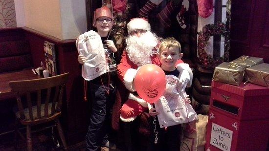 Denton, UK: Luke and Jake enjoying visiting Santa