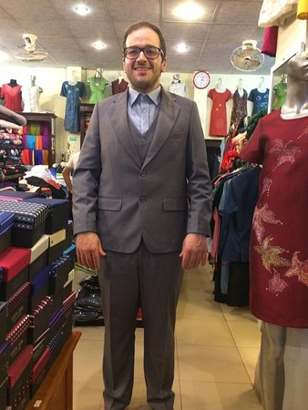 Gia Huy Silk Tailor Shop: Grey suit is item that must have.