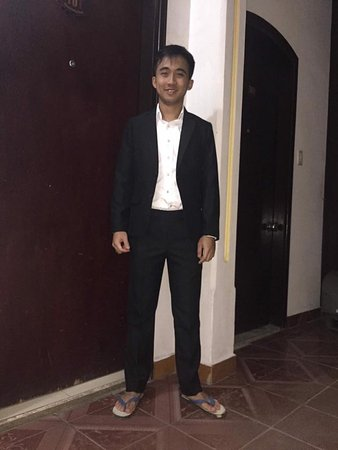 Gia Huy Silk Tailor Shop: He look handsome on black suit.