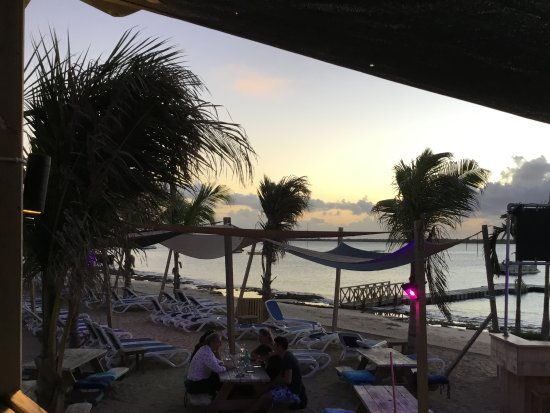 Coco Beach Food: terrace on the beach and beach chairs