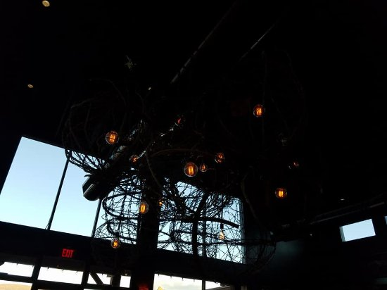 Mariposa Latin Inspired Grill: Very interesting Barbed wire chandelier in Dining Room