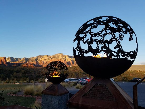 Mariposa Latin Inspired Grill: Entry Fire globes set against Sedona's Red Rock mountains