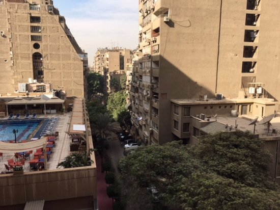 Safir Hotel Cairo: hotel pool  and across residential street