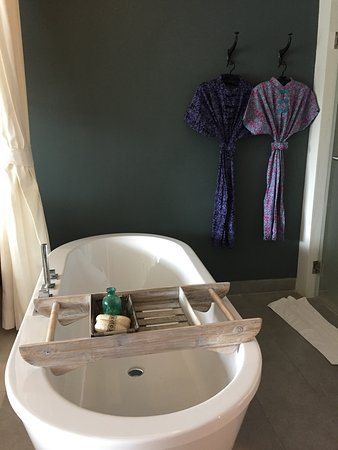 MAI HOUSE Patong Hill: Bathroom of Grand Deluxe room with a comfy tub and interesting bathrobes