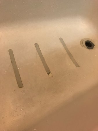 Bathtub safety strips damaged and pulling up - Picture of Sheraton ...