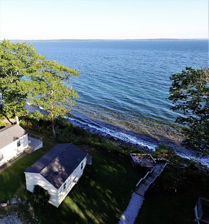 Glenmoor by the Sea: Aerial hotel view of the Oceanfront Cottages, deck and water