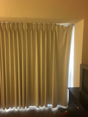 Curtain rod hangers broken and bent; curtains won\'t close ...