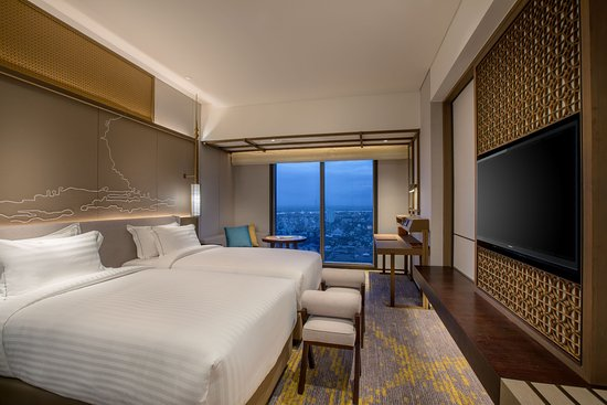 Pan Pacific Yangon: Deluxe Room offers magnificent views of Yangon city, with floor-to-ceiling windows a