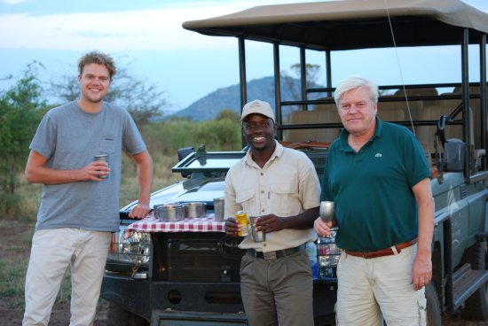 Etali Safari Lodge: A little drink with one of their rangers