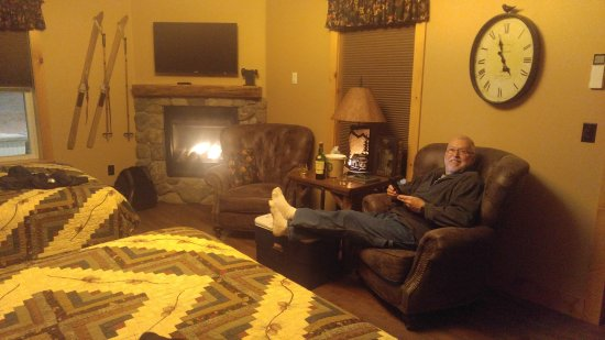 "Woodstock, NH: Dad sipping scotch in his comfy Chair. (Room = ""Echo"")"