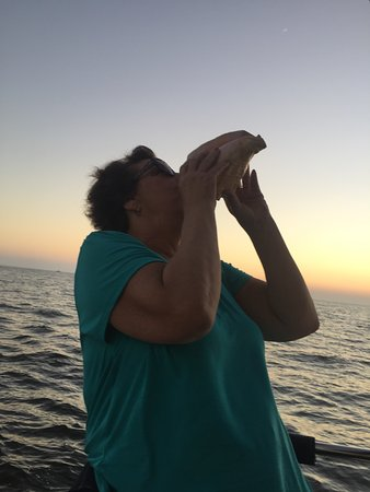 Magic Wind Adventure Sailing: Playing the conch shell at sunset