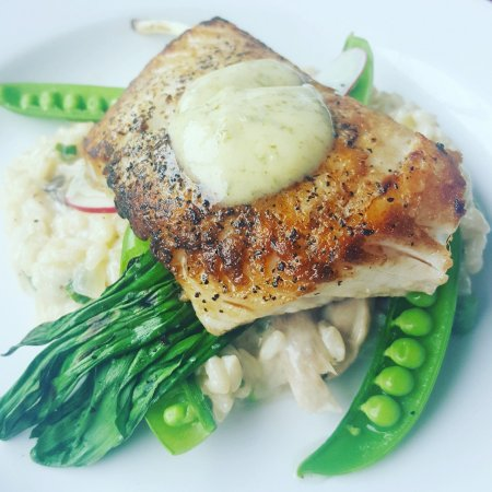 Piney Point, MD: Seared Halibut with crab risotto, wilted ramps and english peas.
