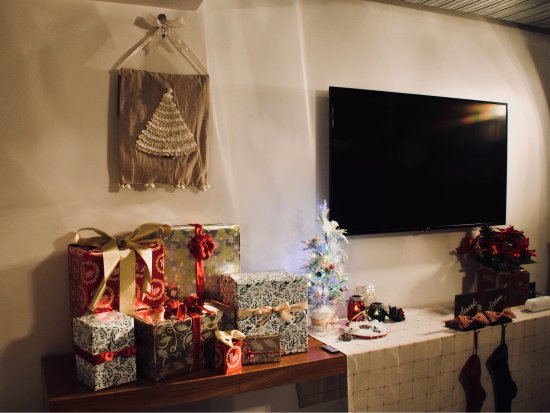 The Nolitan Hotel: Christmas tree and gifts set up in living room suite