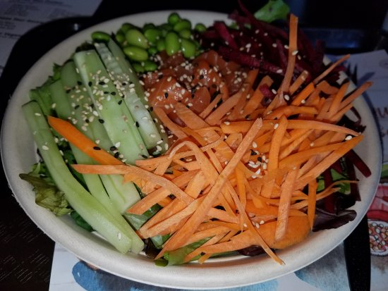 Voorhees, NJ: Salad bowl with salmon, carrots, cucumber, edamame, sliced beets and sesame seeds