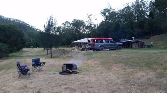 Tabulam, Australia: Fire pits at every site, camp kitchen in the background.