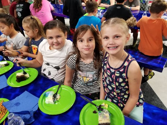 Port Saint Lucie, FL: Rebecca and William Lewis of Vero Beach enjoying an 8th Birthday party at Flying Panda in Port S