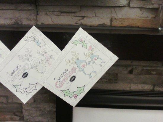 Hampton Inn Carlisle: Cards hanging by the fireplace