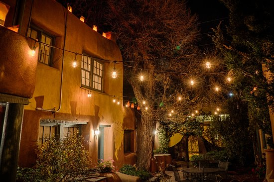 Night lights make an enchanting historic stay in Santa Fe at Pueblo Bonito bed and breakfast inn
