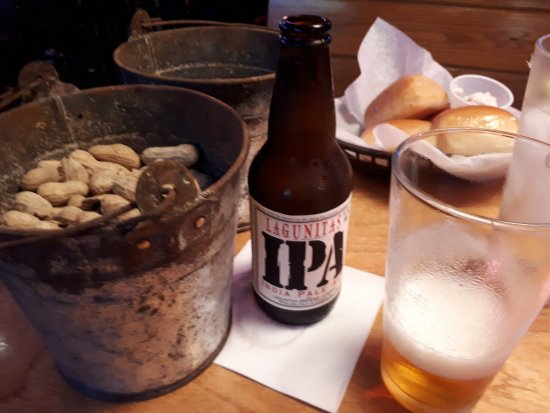 Texas Roadhouse: Beer and peanuts, white bread and whipped butter, bring on the calories.