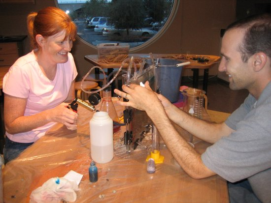 Explora Science Center and Children's Museum of Albuquerque: Adult visitors doing an aquifer experiment at Adult Night.